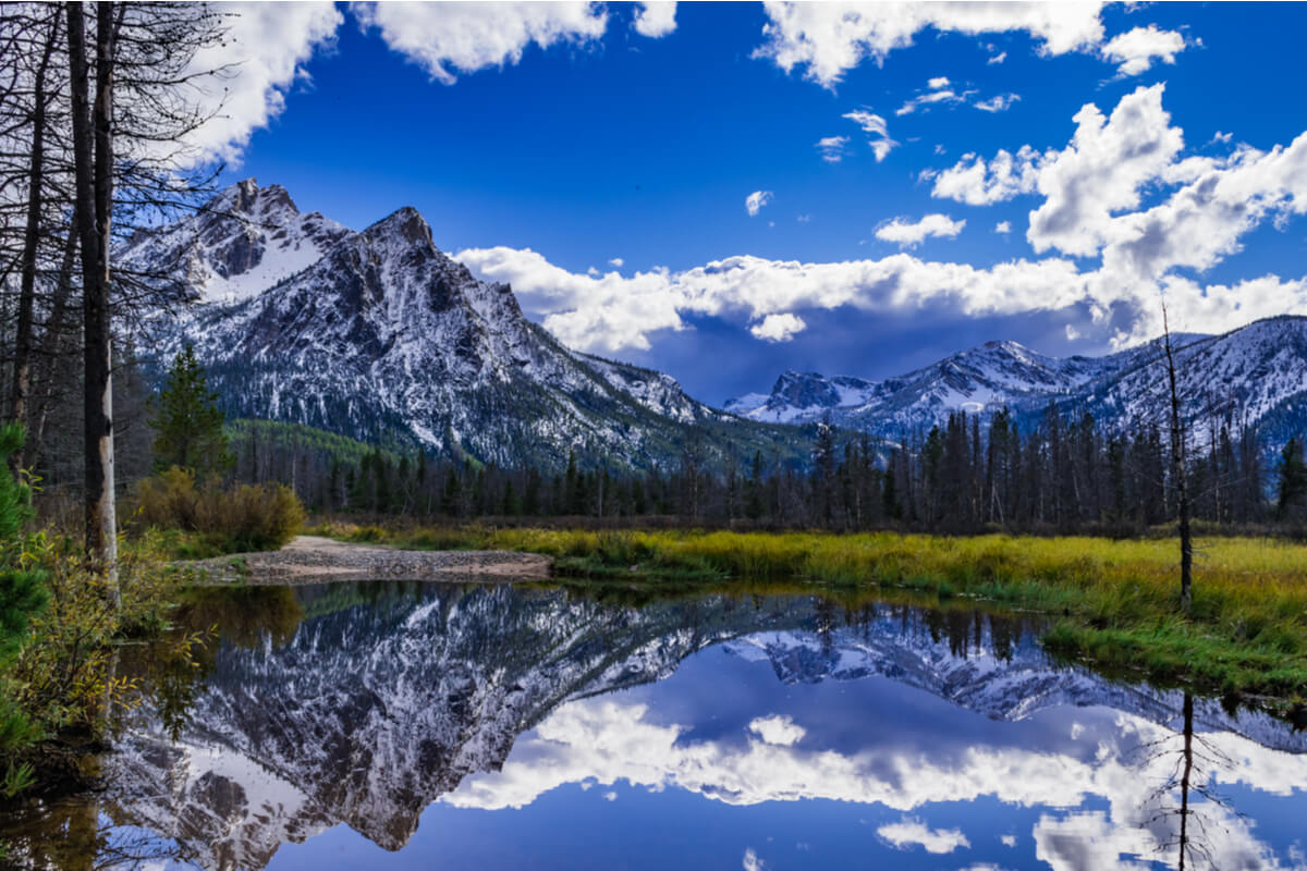 McGown Peak near Stanly Idaho reflected in a pond located in a wetland area near Stanley Lake.
