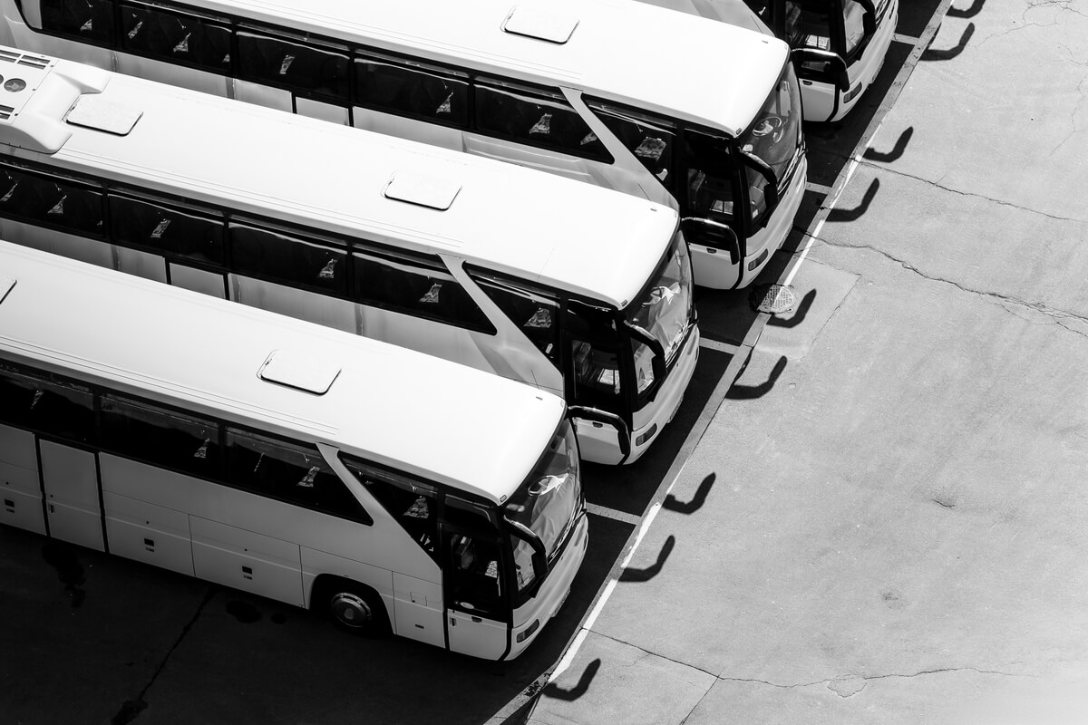 Aerial view of charter buses at a bus station