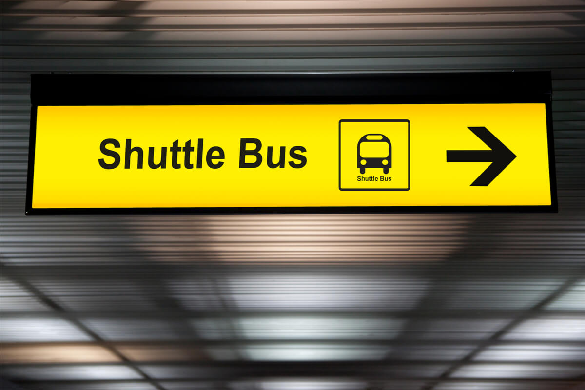hanging shuttle bus sign at airport