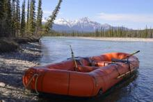 orange raft on river bank